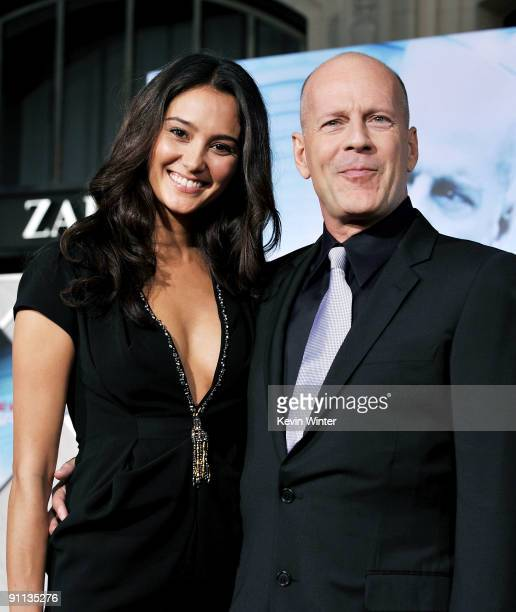 Actor Bruce Willis and his wife Emma Heming arrive at the premiere of Touchstone Pictures' 'Surrogates' at the El Capitan Theater on September 24...