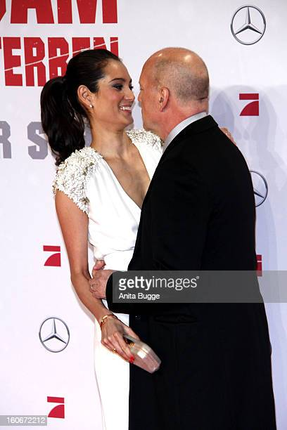 Actor Bruce Willis and his wife Emma Willis attend the 'Die Hard Ein Guter Tag Zum Sterben' Germany premiere at CineStar Sony Center on February 4...