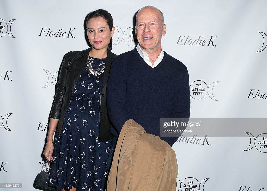Actor Bruce Willis (R) and model Emma Heming attend Tallulah Willis and Mallory Llewellyn celebrate the launch of their new fashion blog 'The Clothing Coven' at Elodie K. on April 4, 2014 in West Hollywood, California.