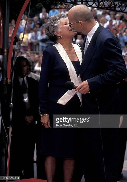 Actor Bruce Willis and mother Marlene Willis attend Bruce Willis' Hand Footprints in Cement Ceremony on May 18 1995 at Mann's Chinese Theatre in...