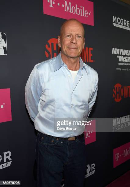 Actor Bruce Willis arrives on TMobile's magenta carpet duirng the Showtime WME IME and Mayweather Promotions VIP PreFight Party for Mayweather vs...