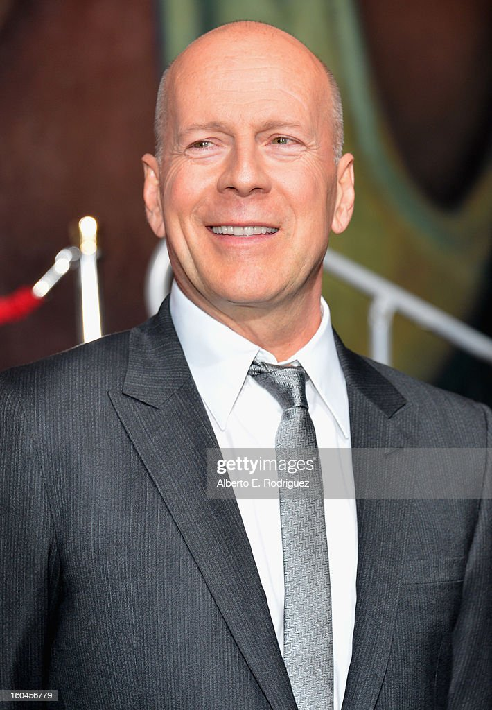Actor Bruce Willis attends the dedication and unveiling of a new soundstage mural celebrating 25 years of 'Die Hard' at Fox Studio Lot on January 31, 2013 in Century City, California.