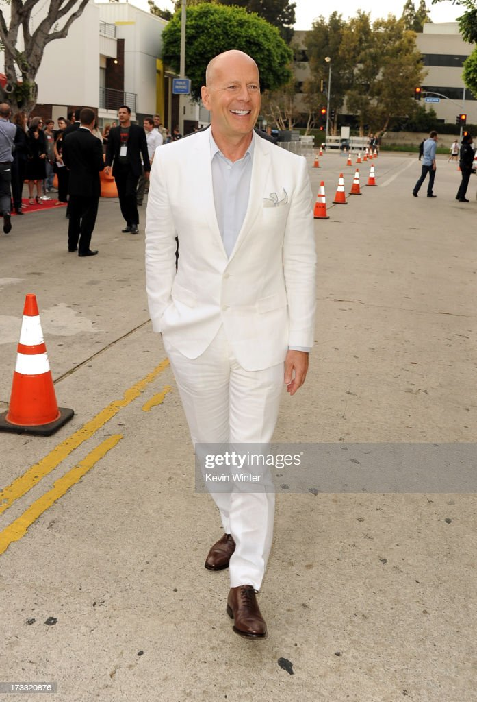 Actor Bruce Willis attends the premiere of Summit Entertainment's 'RED 2' at Westwood Village on July 11, 2013 in Los Angeles, California.
