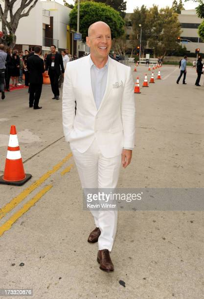 Actor Bruce Willis attends the premiere of Summit Entertainment's RED 2 at Westwood Village on July 11 2013 in Los Angeles California