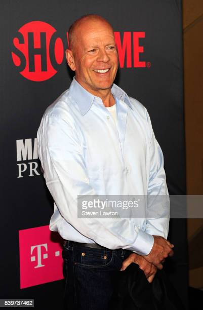 Actor Bruce Willis attends the VIP party before the boxing match between boxer Floyd Mayweather Jr and Conor McGregor at TMobile Arena on August 26...