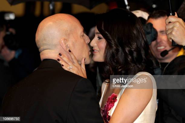 Actor Bruce Willis gives his wife Emma Heming a kiss as they attend the 'Red' UK Premiere at the Royal Festival Hall on October 19 2010 in London...
