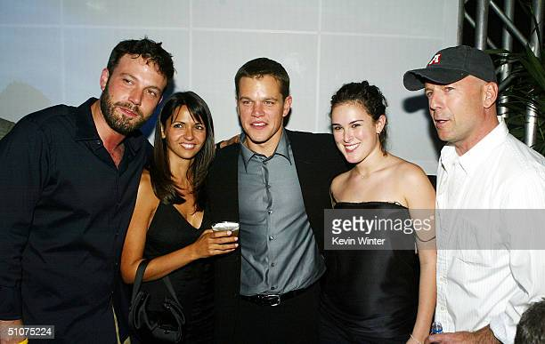 Actor Bruce Willis, his daughter Rumer Willis, actor Matt Damon, his girlfriend Luciana Bozan and actor Ben Affleck pose at the after party for the...