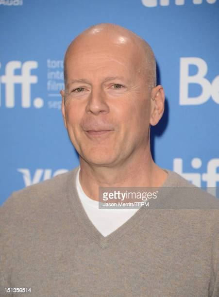 Actor Bruce Willis poses at the 'Looper' photo call during the 2012 Toronto International Film Festival at TIFF Bell Lightbox on September 6 2012 in...