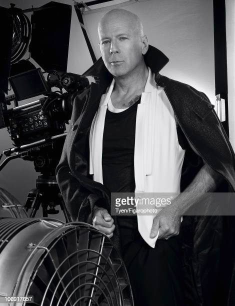 Actor Bruce Willis poses for Madame Figaro in Paris on June 15 2010 Published image Trench by John Galliano vest by Maison Martin Margiela pants by...