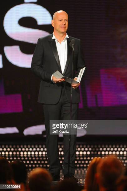 Actor Bruce Willis speaks onstage at the First Annual Comedy Awards at Hammerstein Ballroom on March 26, 2011 in New York City.