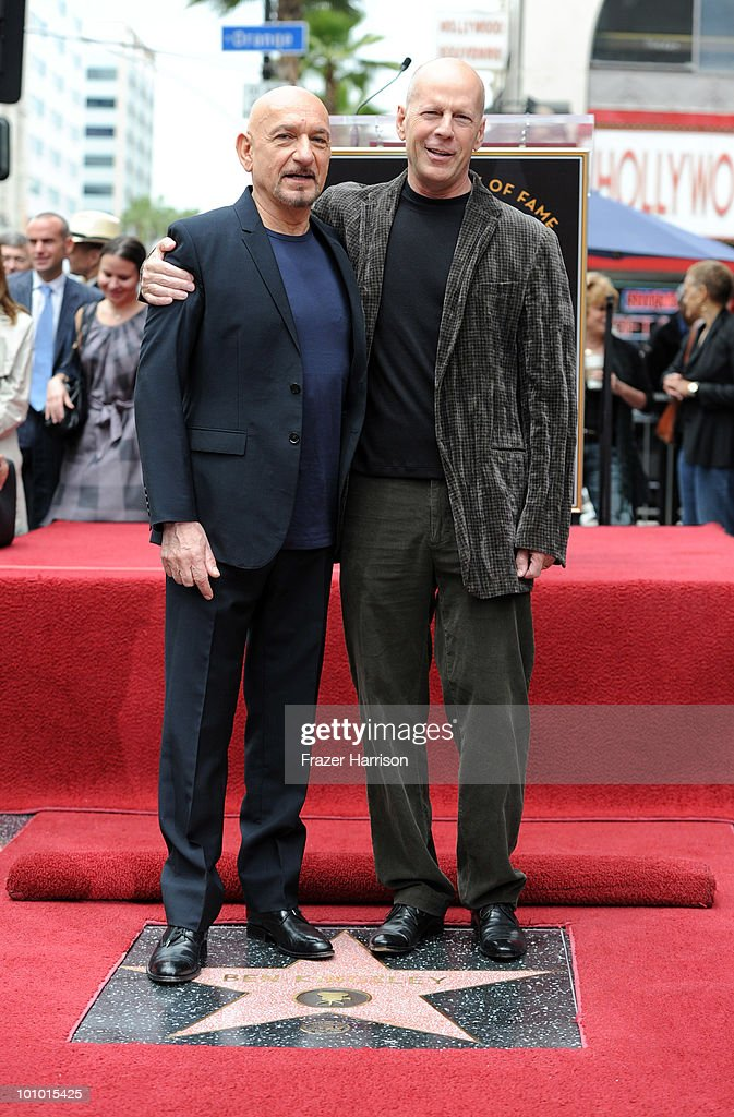 Actor Bruce Willis (right) stands with actor Sir Ben Kingsley who was honored with the 2,410th Star on the Hollywood Walk of Fame on May 27, 2010 in Hollywood, California.