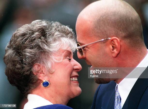 Actor Bruce Willis with his mother Marlene whilst leaving his handprints in cement at Mann's Chinese Theatre in Hollywood California 18th May 1995