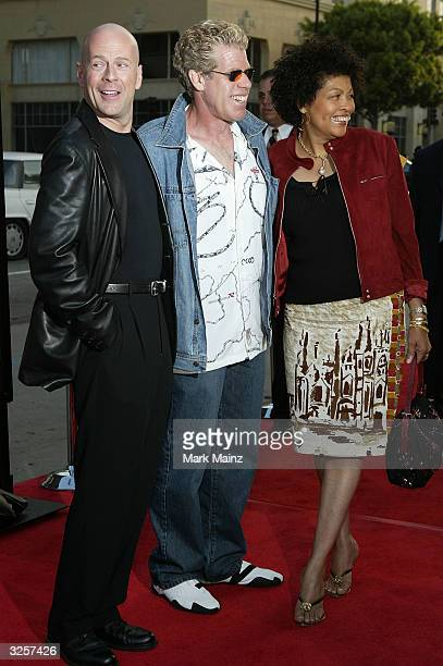Actor Bruce Willis with Ron and Opal Perlman attend The Whole Ten Yards Premiere at the Chinese Theatre April 7 2004 in Los Angeles California