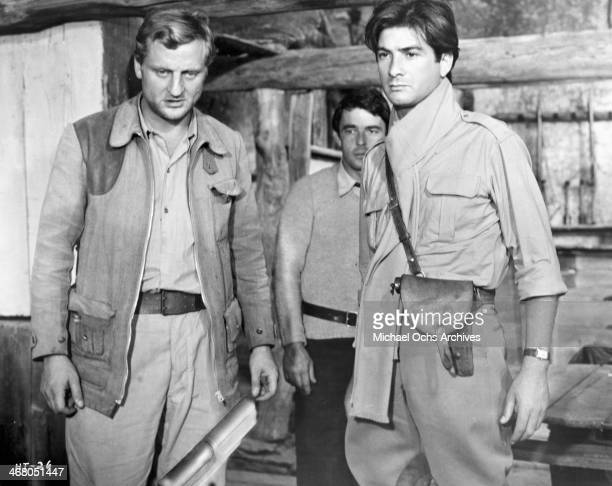 Actor Bruno Cremer JeanClaude Brialy and Gerard Blain on set of the movie Shock Troops circa 1967