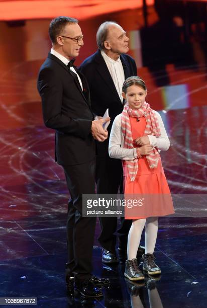 Actor Bruno Ganz actress Anuk Steffen and presenter Christoph Suess stand on stage during the Bavarian Film Prize 2016 award ceremony in Munich...