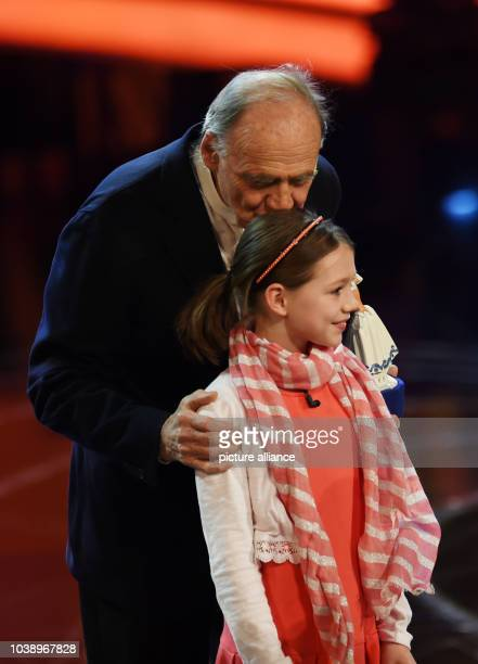 Actor Bruno Ganz and actress Anuk Steffen stand on stage during the Bavarian Film Prize 2016 award ceremony in Munich Germany 15 January 2016 The...