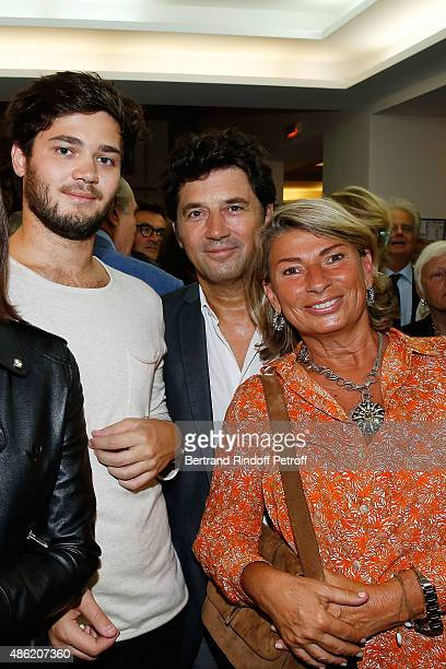Actor Bruno Madinier and his Wife Camille Jean-Robert and his son Louis Madinier attend 'Les Voeux du Coeur' Premiere at Theatre La Bruyere on August...