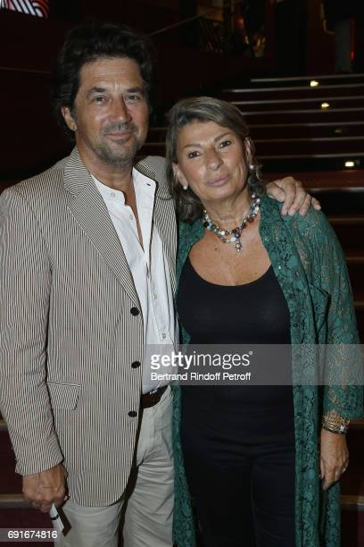 """Actor Bruno Madinier and his wife Camille Jean-Robert attend """"Les Coquettes"""" Musical Show at L'Olympia on June 2, 2017 in Paris, France."""