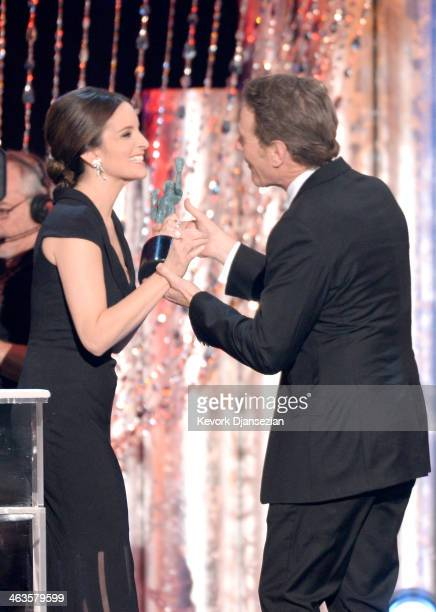 Actor Bryan Cranston accepts the Outstanding Performance by an Ensemble in a Drama Series award for 'Breaking Bad' from actress Tina Fey onstage...