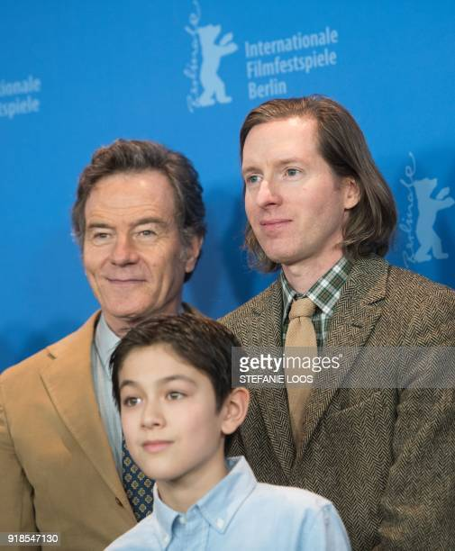 US actor Bryan Cranston Canadianborn actor Koyu Rankin and US director Wes Anderson pose during a photocall upon arrival for a press conference to...