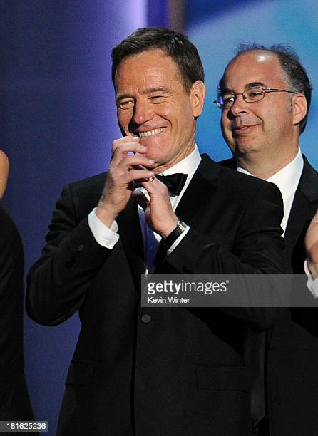 Actor Bryan Cranston claps onstage as 'Breaking Bad' wins Best Drama Series during the 65th Annual Primetime Emmy Awards held at Nokia Theatre LA...