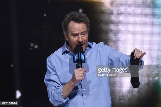 Actor Bryan Cranston holds up a sock on stage at WE Day California April 27 2017 at The Forum in InglewoodCalifornia WE Day California is a...
