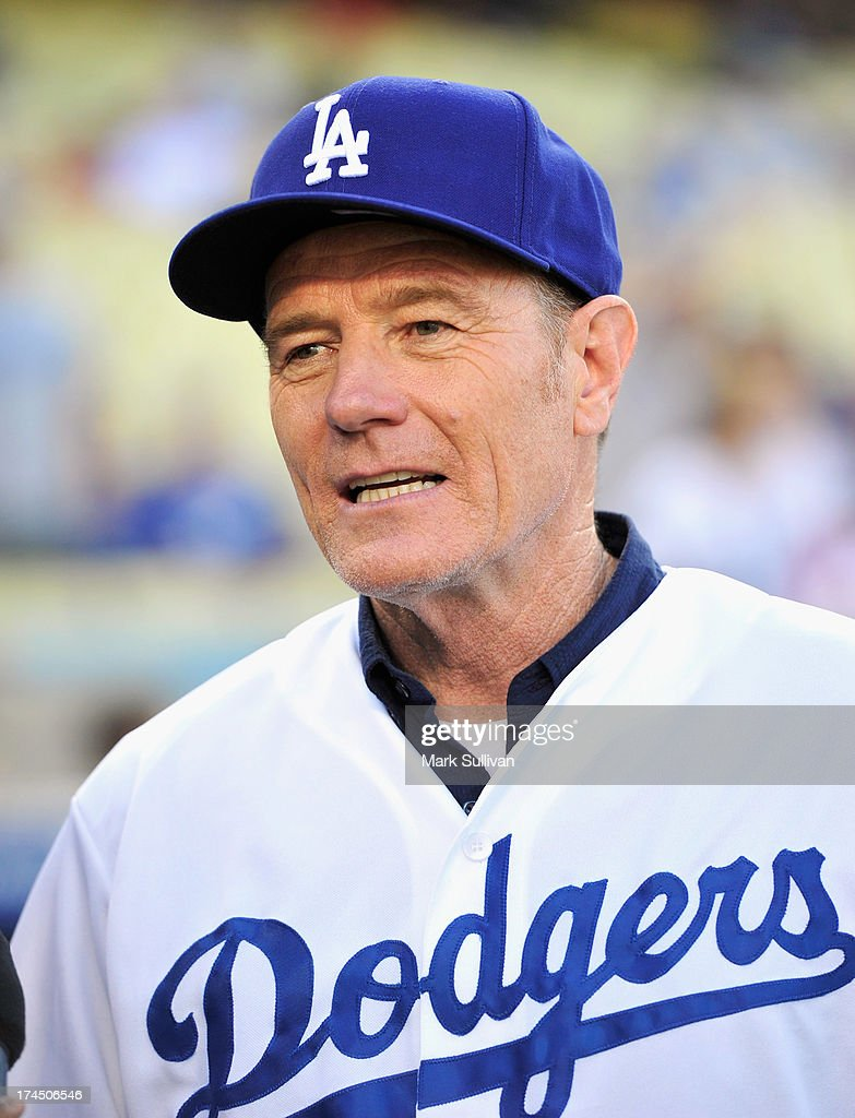 Actor Bryan Cranston on the field before throwing out the ceremonial first pitch before the MLB game between the Cincinnatti Reds and Los Angeles Dodgers at Dodger Stadium at Dodger Stadium on July 26, 2013 in Los Angeles, California.