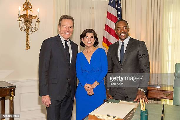 Actor Bryan Cranston philanthropist Luci Baines Johnson and actor Anthony Mackie pose in the replica of the Oval Office before the Premiere of HBO's...