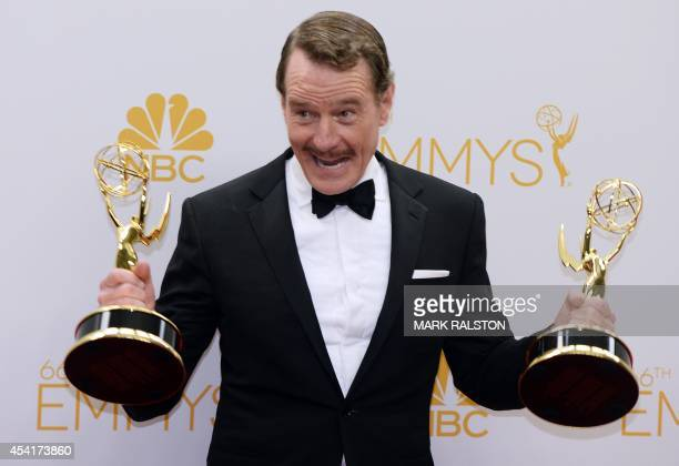 Actor Bryan Cranston poses in the press room after winning the Outstanding Drama Series Award and Outstanding Lead Actor in a Drama Series for...
