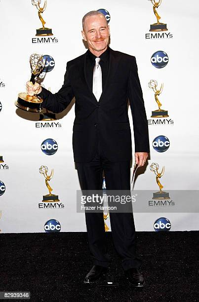 "Actor Bryan Cranston poses in the press room with his Emmy for Outstanding Lead Actor in a Drama Series for ""Breaking Bad"" during the 60th Primetime..."