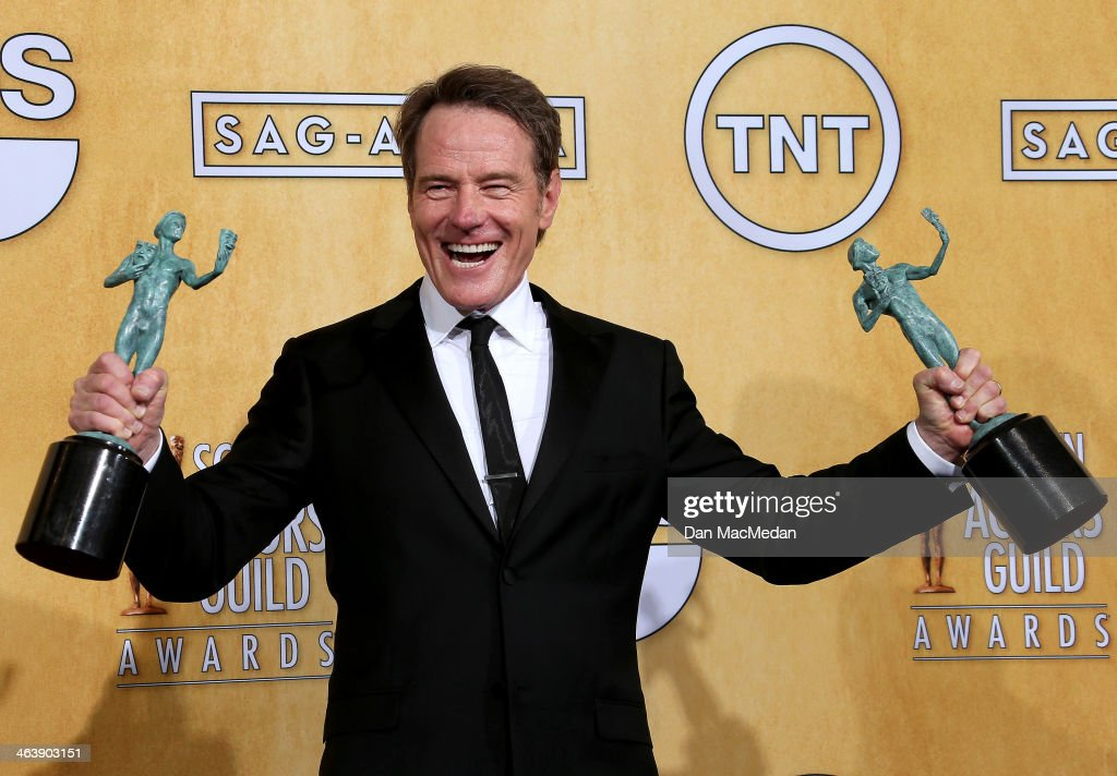 Actor Bryan Cranston poses in the press room with the award for Outstanding Performance by an Ensemble in a Drama Series for 'Breaking Bad' at the 20th Annual Screen Actors Guild Awards at the Shrine Auditorium on January 18, 2014 in Los Angeles, California.