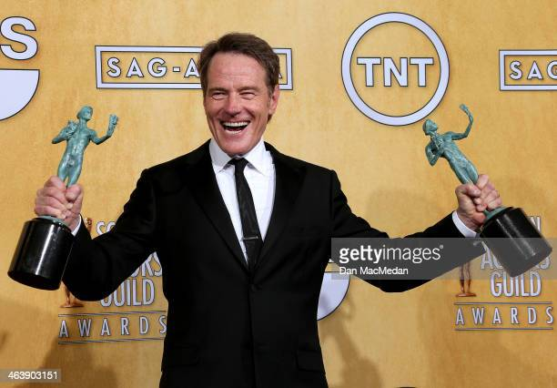 Actor Bryan Cranston poses in the press room with the award for Outstanding Performance by an Ensemble in a Drama Series for 'Breaking Bad' at the...
