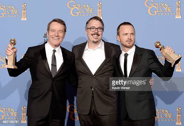 Actor Bryan Cranston, writer-producer Vince Gilligan, and actor Aaron Paul, winners of Best Series - Drama for 'Breaking Bad,' pose in the press room...
