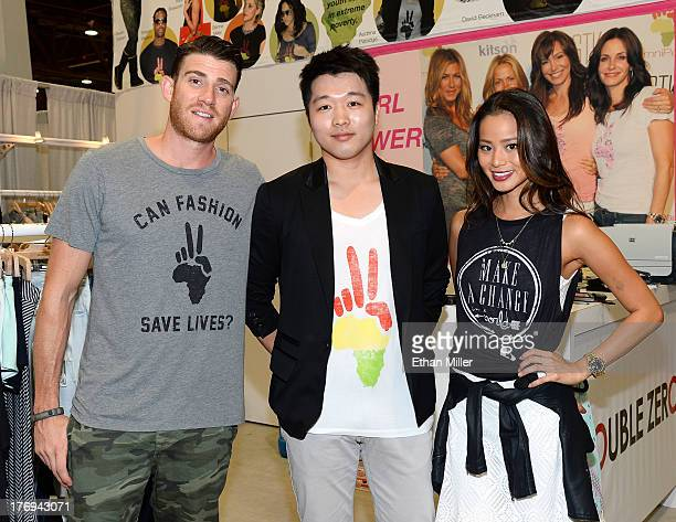 Actor Bryan Greenberg OmniPeace designer Jason Kim and actress Jamie Chung appear at the OmniPeace by Double Zero booth during MAGIC Market Week at...