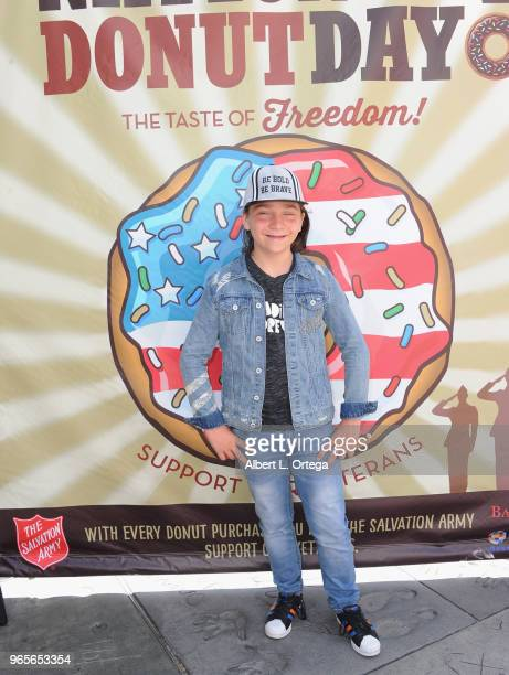Actor Bryson Robinson participates in The Salvation Army And Bakemark's 2nd Annual National Donut Day World Donut Eating Championship To Benefit...