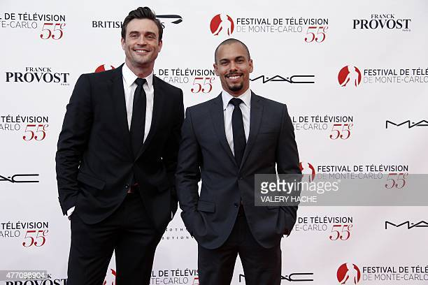 US actor Bryton James and Australian model and actor Daniel Goddard pose during the opening ceremony of the 55th MonteCarlo Television Festival on...