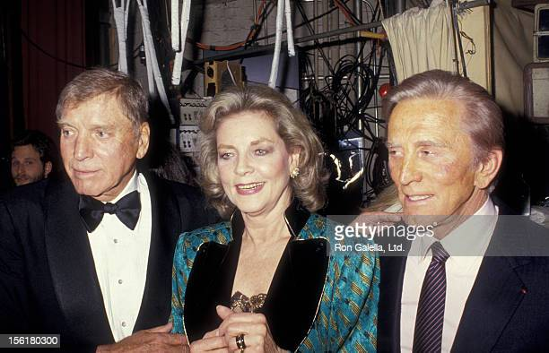 Actor Burt Lancaster actress Lauren Bacall and actor Kirk Douglas attend Tribute Gala Honoring Kirk Douglas on April 6 1987 at the Majestic Theater...