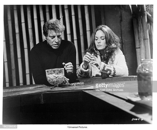 Actor Burt Lancaster and actress Cathy Bach on the set of the Universal Pictures movie The Midnight Man in 1974