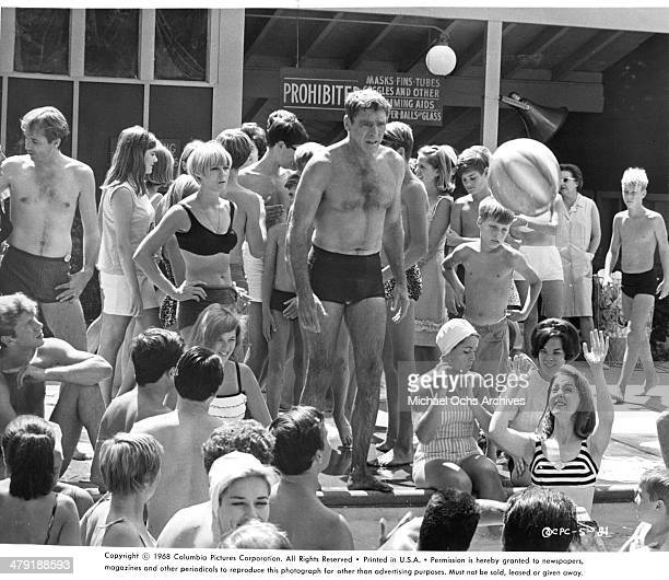 Actor Burt Lancaster looks to jump into a swimming pool in a scene from the Columbia Pictures movie The Swimmer circa 1968