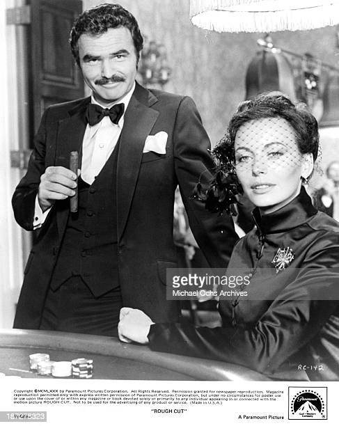 """Actor Burt Reynolds and actress Lesley-Anne Down on set of the Paramount Pictures movie """"Rough Cut"""" in 1980."""