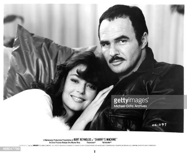 Actor Burt Reynolds and actress Rachel Ward pose on set of the movie Sharky's Machine circa 1981
