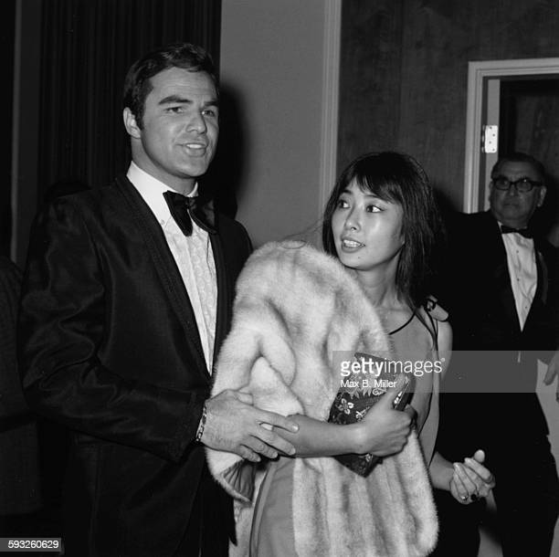 Actor Burt Reynolds and his date actress Miko Mayama at the Golden Globe Awards Los Angeles February 1971
