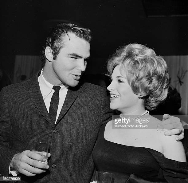 Actor Burt Reynolds attends an event with a friend in Los AngelesCA