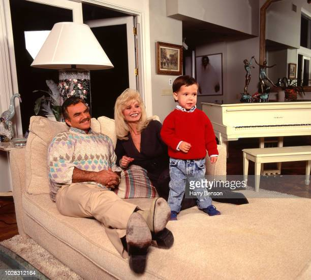 Actor Burt Reynolds with his wife Loni Anderson and their adopted son Quinton Anderson Reynolds are photographed at their home in 1993 in Los Angeles...