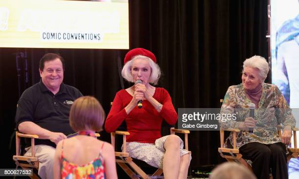 Actor Burt Ward actresses Julie Newmar and Lee Meriwether speak to an attendee during the 'Celebrate Batman '66 Special Panel' at the Amazing Las...