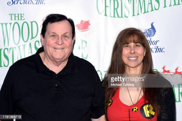 Actor Burt Ward and Tracy Ward attend the 88th annual Hollywood Christmas Parade on December 01 2019 in Hollywood California