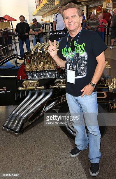 Actor Butch Patrick poses in front of the Munster Koach at the opening ceremony of Las Vegas Car Stars at the Fremont Street Experience on May 17...