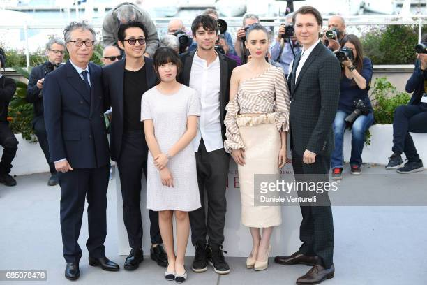 Actor Byung Heebong Steven Yeun Ahn SeoHyun Devon Bostick Lily Collins and Paul Dano attend the 'Okja' photocall during the 70th annual Cannes Film...