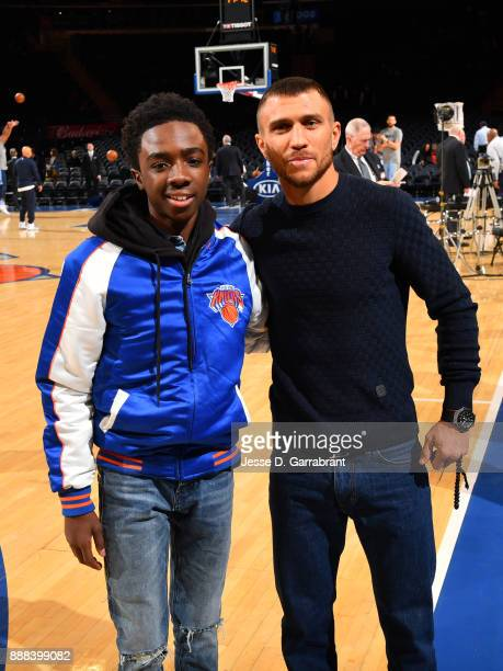 Actor Caleb McLaughlin and Vasyl Lomachenko attends the NBA game between the Memphis Grizzlies and the New York Knicks at Madison Square Garden on...