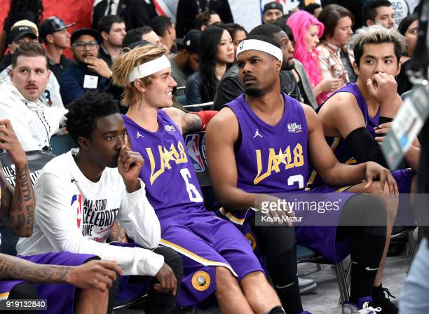 Actor Caleb McLaughlin recording artist Justin Bieber TV personality/recording artist Sterling Brim and actor Kris Wu sit during the NBA AllStar...